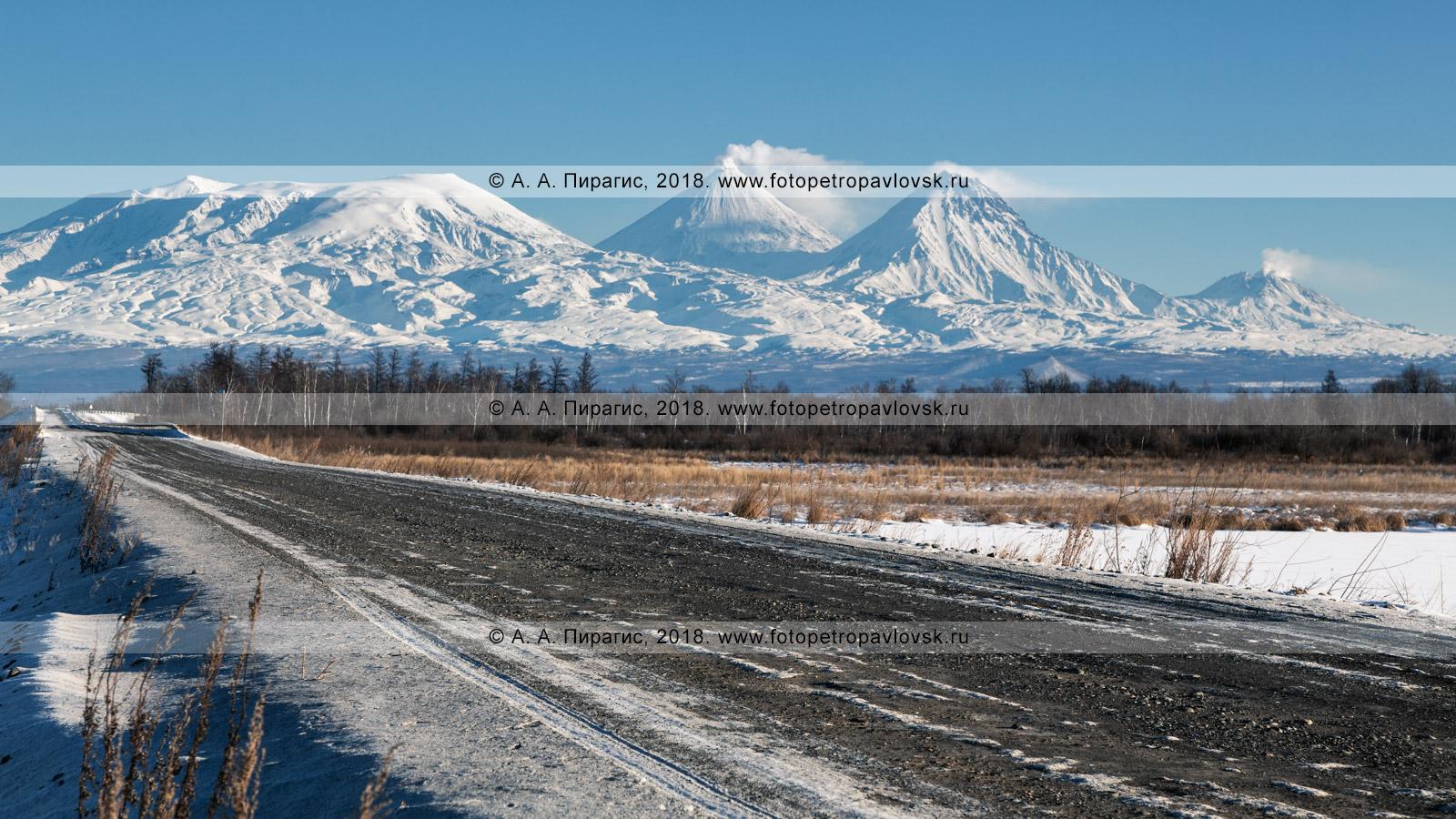 Фотография: зимняя камчатская дорога фоне вулканов Ключевской группы